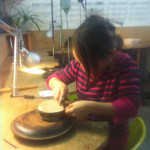 Children at work on our family workshops in jewellery making