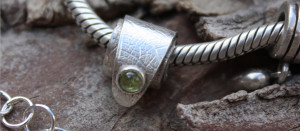 silver charm with peridot, by on of our Flux Jewellery School students