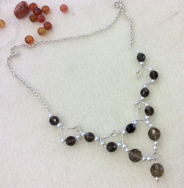 cascade bead and wire necklace made by a  WCTRA resident