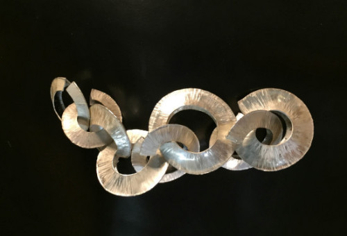 beautiful hammered and folded forms in silver, interlinked to make a necklace